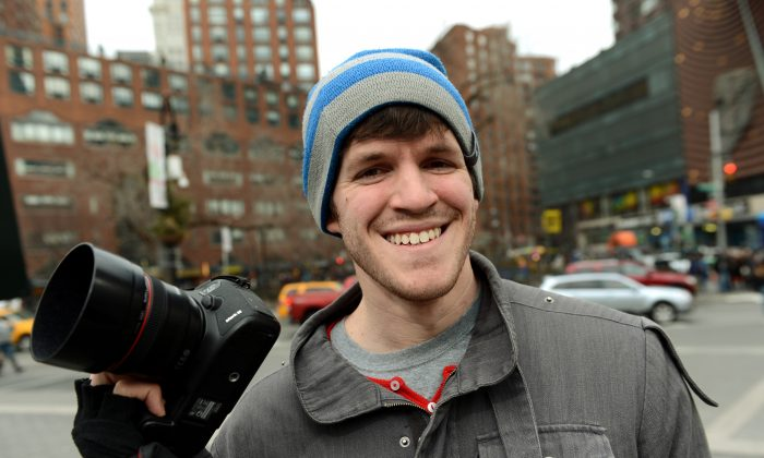 Brandon Stanton, creator of the Humans of New York blog, with his camera February 22, 2013 across the street from Union Square in New York. ( STAN HONDA/AFP/Getty Images)