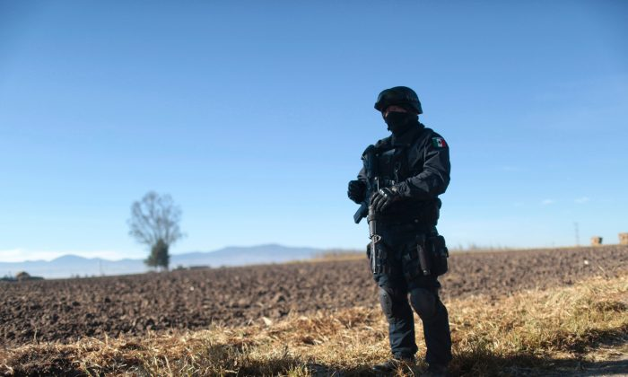 A Mexican Federal Police officer stands guard near the Almoloya Prison in Almoloya de Juarez, Mexico, on Jan. 9, 2016. (Pedro Parto/AFP/Getty Images)