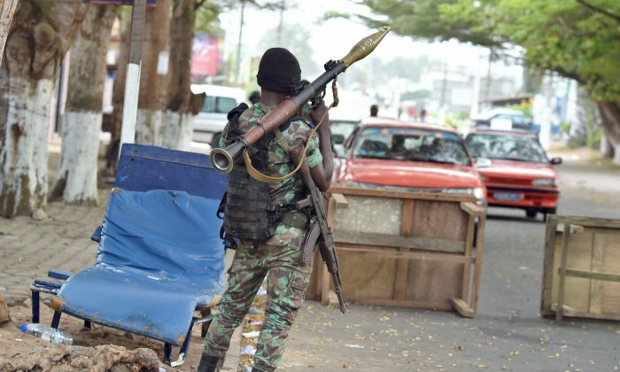 An Ivorian soldier holds a Rocket-propelled grenade while manning a position in a street near the the Etoile du Sud hotel in Grand Bassam on March 14, 2016 a day after heavily armed gunmen opened fire at a hotel in the Ivory Coast beach resort. Gunmen killed 16 people at an Ivory Coast resort on March 13 leaving bodies strewn on the beach, in an attack claimed by an Al-Qaida affiliate as fears grow of a mounting jihadist threat in west Africa. Armed with grenades and assault riffles, the attackers stormed three hotels in the sleepy resort of Grand-Bassam, popular with expats, around 25 miles east of the commercial hub Abidjan. (Issouf Sanogo/AFP/Getty Images)
