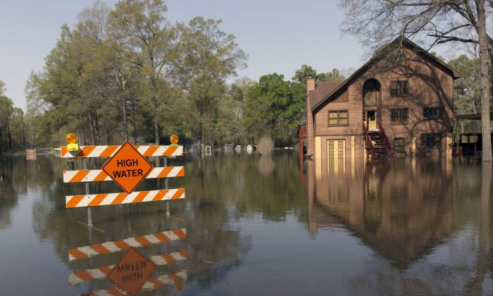 A sign marks high water in a flooded section of in Oil City, La., Sunday, March 13, 2016. (Lee Celano/The Shreveport Times via AP)