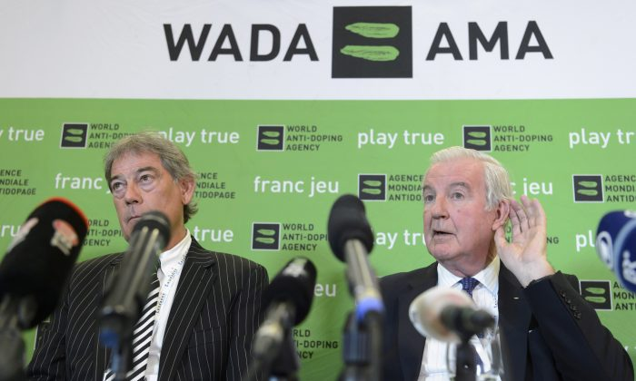 David Howman (L), from New Zealand, director-general of World Anti-Doping Agency (WADA), and Britain's Craig Reedie (R), president of WADA, at a press conference during the WADA Symposium for Anti-Doping Organizations (ADOs) in Lausanne, Switzerland, on March 14, 2016. (Laurent Gillieron/Keystone via AP)