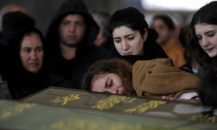 Members of Cermik family attend the funeral processions for three members of their family killed in Sunday's explosion in Ankara, Turkey, Monday, March 14, 2016. A senior government official told The Associated Press that authorities believe the attack was carried out by two bombers, one of them a woman, and was the work of Kurdish militants. It was the second deadly attack blamed on Kurdish militants in the capital in the past month. (AP Photo)