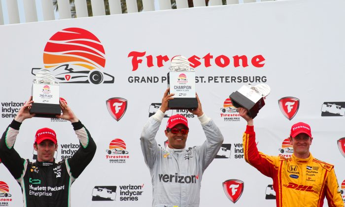 (L-R) Simon Pagenaud, Juan Montoya, and Ryan Hunter-Reay raise their trophies after the Verizon IndyCar Grand Prix of St. Petersburg, Sunday, March 13, 2016. (Chris Jasurek/Epoch Times)
