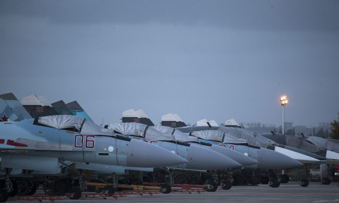 Russian fighter jets and bombers are parked at Hemeimeem airbase in Syria on March 4, 2016. (AP Photo/Pavel Golovkin)