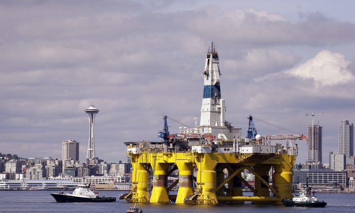In this May 14, 2015, file photo, the oil drilling rig Polar Pioneer is towed toward a dock in Elliott Bay in Seattle. (AP Photo/Elaine Thompson, File)