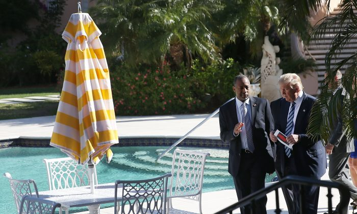 Republican presidential candidate Donald Trump walks with former presidential candidate Ben Carson before he receives his endorsement at the Mar-A-Lago Club on March 11, 2016 in Palm Beach, Florida. (Photo by Joe Raedle/Getty Images)