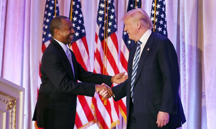 PALM BEACH, FL - MARCH 11:  Republican presidential candidate Donald Trump shakes hands with former presidential candidate Ben Carson as he receives his endorsement at the Mar-A-Lago Club on March 11, 2016 in Palm Beach, Florida. Presidential candidates continue to campaign before Florida's March 15th primary day.  (Photo by Joe Raedle/Getty Images)
