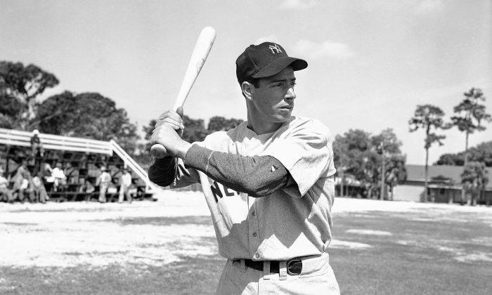 Joe DiMaggio with bat ready at first days workout on March 6, 1946 in Bradenton, Florida after returning from Panama. DiMaggio has been out since 1942 for with U.S. Army service. (AP Photo/PS)