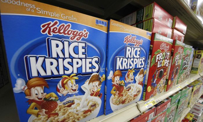 In a Wednesday, July 18, 2012, file photo, Kellogg's cereals are on display at a Pittsburgh grocery market. Kellogg says a criminal investigation is underway after a video surfaced online showing a man urinating on one of its factory assembly lines. The company says it learned of the video Friday, March 11, 2016, and immediately alerted authorities. It says the criminal investigation is being conducted by the U.S. Food and Drug Administration. Kellogg said its own investigation determined the video was recorded at its Memphis, Tenn., factory in 2014. (AP Photo/Gene J. Puskar, File)