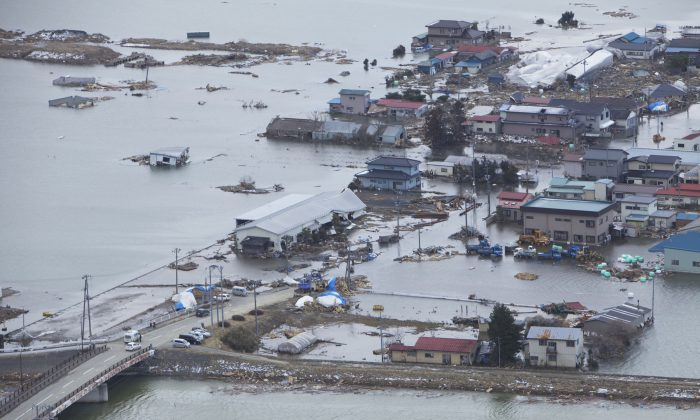 An aerial view of Minato, Japan, on March 18, 2011, a week after a 9.0 magnitude earthquake and subsequent tsunami that devastated the area. (Lance Cpl. Ethan Johnson/U.S. Marine Corps)