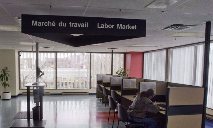 A man looks through jobs at a Resource Canada office in Montreal. (The Canadian Press/Ryan Remiorz)