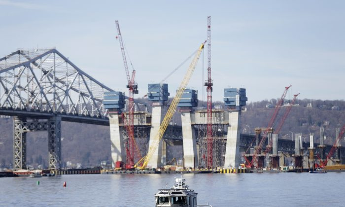 A New York State Police boat passes near the site of a fatal collision in the water underneath the Tappan Zee Bridge in Tarrytown, N.Y., March 12, 2016. A tugboat crashed into a barge on the Hudson River north of New York City early March 12  killing at least one crew member and leaving two still missing. (Seth Wenig/AP Photo)