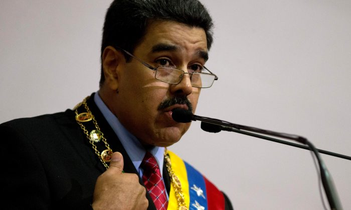 Venezuela's President Nicolas Maduro gives his annual state of the nation address in Caracas, Venezuela, on Jan. 15, 2016. (AP Photo/Fernando Llano)