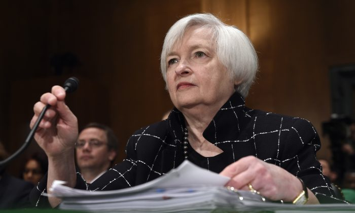 Federal Reserve Board Chair Janet Yellen prepares to testify on Capitol Hill in Washington, Thursday, Feb. 11, 2016, before the Senate Banking Committee hearing on: 'The Semiannual Monetary Policy Report to the Congress.' (AP Photo/Susan Walsh)