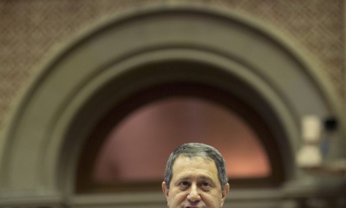 Assembly Majority Leader Joseph Morelle, D-Rochester, speaks in the Assembly Chamger at the Capitol on Tuesday, March 15, 2016, in Albany, N.Y. The Assembly plans to vote on limiting legislators' outside income to about $70,000 annually and to treat limited liability companies like other businesses that can give a candidate only $5,000 a year. (AP Photo/Mike Groll)