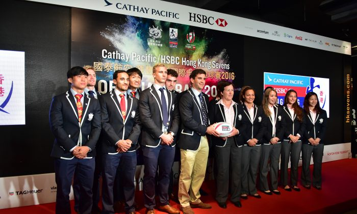 Men and women from the Hong Kong sevens teams plus their respective coaches, Gareth Baber and Anna Richard at the draw ceremony in Hong Kong on Monday March 14, 2016.  (Bill Cox/Epoch Times)