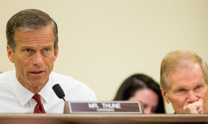 FILE - In this June 10, 2015, file photo, chairman John Thune, R-S.D. (L) speaks during a Senate Commerce, Science and Transportation hearing on Capitol Hill in Washington.  (AP Photo/Andrew Harnik, File)