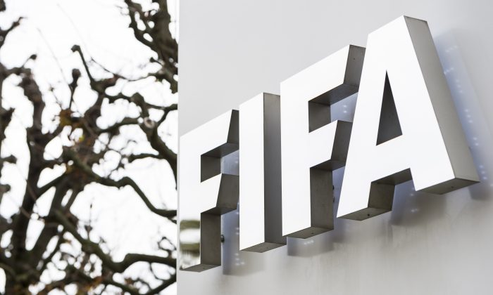 This is a Thursday, Oct. 8, 2015 file photo of the FIFA logo  pictured at the FIFA headquarters in Zurich, Switzerland. (Dominic Steinmann/Keystone via AP)