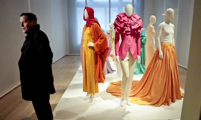 Fashion designer Isaac Mizrahi backs prepares for a press preview tour of his solo exhibition at the Jewish Museum on Monday, March 14, 2016, in New York. (AP Photo/Bebeto Matthews)