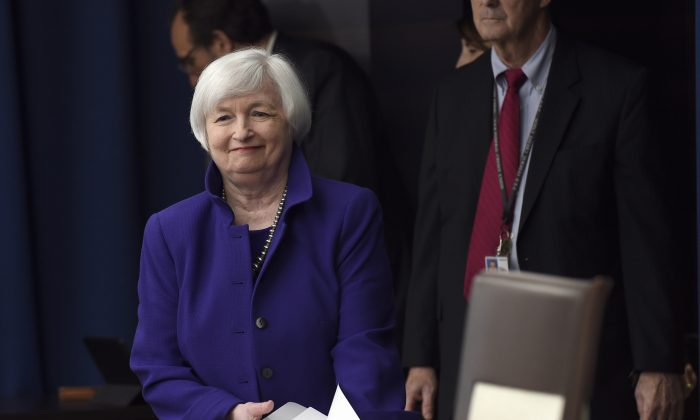 FILE - In this Wednesday, Dec. 16, 2015, file photo, Federal Reserve Chair Janet Yellen arrives for a news conference in Washington, to speak following an announcement that the Federal Reserve raised its key interest rate by a quarter-point. (AP Photo/Susan Walsh, File)