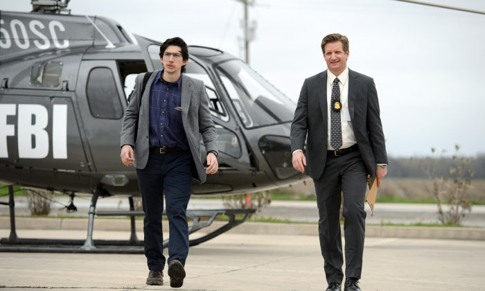 """This image released by Warner Bros. Entertainment shows Adam Driver, left, and Paul Sparks in a scene from """"Midnight Special."""" (Ben Rothstein/Warner Bros. Entertainment via AP)"""