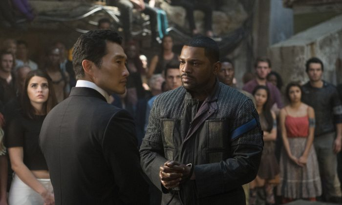 """This image released by Lionsgate shows Daniel Dae Kim (L) and Mekhi Phifer in a scene from """"The Divergent Series: Allegiant."""" (Murray Close/Lionsgate via AP)"""