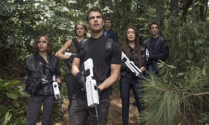 """This image released by Lionsgate shows from left, Zoe Kravitz, Shailene Woodley, Theo James, Ansel Elgort, Maggie Q and Miles Teller in a scene from """"The Divergent Series: Allegiant."""" (Murray Close/Lionsgate via AP)"""