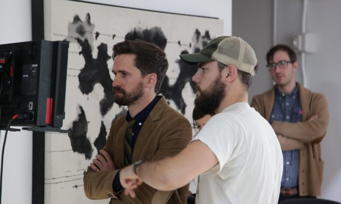 """This image released by Magnolia Pictures shows director Benjamin Dickinson, left, on the set of his film, """"Creative Control."""" (Magnolia Pictures via AP)"""
