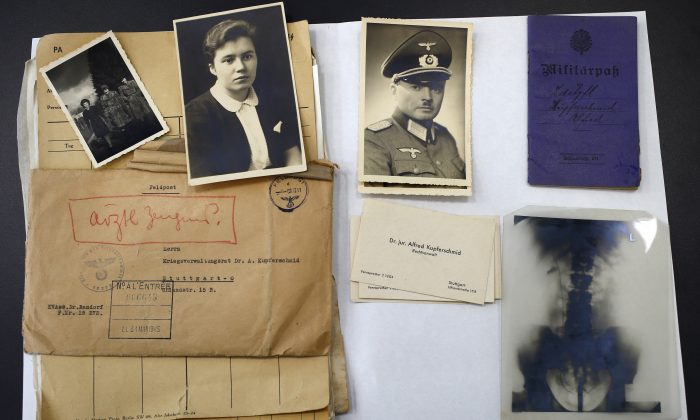 The files of a Nazi German officer, stored for years in the archives rooms of the medieval castle of Vincennes, are displayed in Vincennes, east of Paris, on March 16, 2016. (AP Photo/Francois Mori)