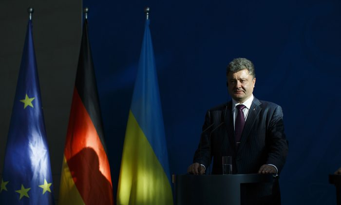 Ukrainian President Petro Poroshenko and German Chancellor Angela Merkel (not pictured) give statements to the media prior to talks at the Chancellery in Berlin, Germany, on June 5, 2015. (Carsten Koall/Getty Images)