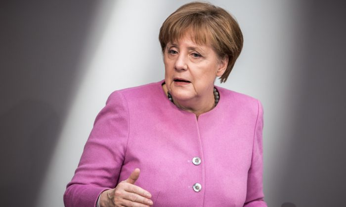 German Chancellor Angela Merkel (C) speaks at the Bundestag (lower house of parliament) in Berlin on March 16, 2016. (Michael Kappeler/AFP/Getty Images)