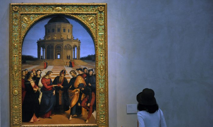 """A visitor look sat a painting at the  """"Pinacoteca di Brera"""" gallery in Milan on August 13, 2009. (GIUSEPPE CACACE/AFP/Getty Images)"""