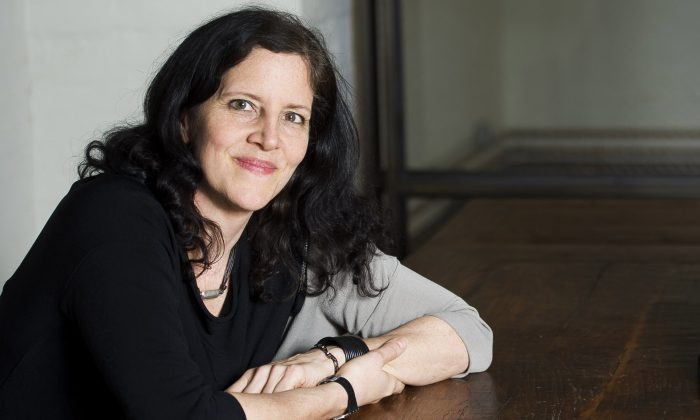 """FILE - In this April 16, 2014 file photo, Laura Poitras poses for a portrait in New York.  Poitras has a solo exhibition titled, """"Astro Noise,"""" showing at the Whitney Museum of American Art through May 1. (Photo by Charles Sykes/Invision/AP, File)"""