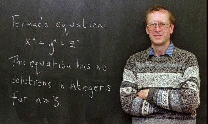 """Princeton University mathematics professor Andrew John Wiles poses next to """"Fermat's Last Theorem"""" written on a chalkboard in his Princeton, N.J., office Tuesday, Jan. 6, 1998. Wiles, 44, a native of Cambridge, England, was awarded the $200,000 1998 King Faisal International Prize for solving the 350-year-old mathematical puzzle that scores of mathematicians could not. (AP Photo/Charles Rex Arbogast)"""