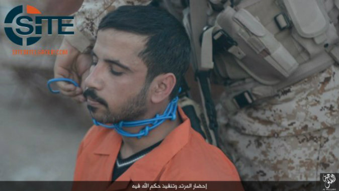 An ISIS prisoner being executed in the city of Falluhjah, Iraq (SITE)