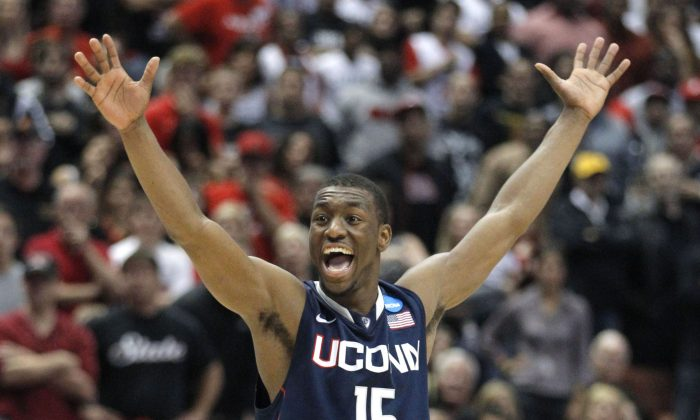 Connecticut's Kemba Walker averaged 23.5 points per game in leading UConn to the 2011 National Championship. (AP Photo/Jae C. Hong)