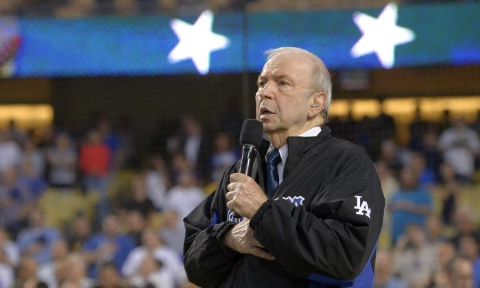 Frank Sinatra, Jr. sings the national anthem prior to a baseball game between the LA Dodgers and the Pittsburgh Pirates in Los Angeles. Sinatra Jr., died unexpectedly, March 16, 2016, of cardiac arrest while on tour in Daytona Beach, Fla.  He was 72. (AP Photo/Mark J. Terrill)