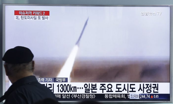 A man watches a TV screen showing a file footage of the missile launch conducted by North Korea, at Seoul Railway Station in Seoul, South Korea, Friday, March 18, 2016. (AP Photo/Ahn Young-joon)