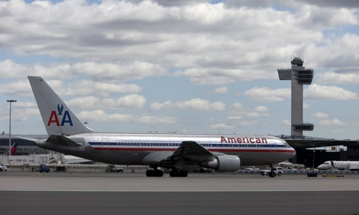 File: An American Airlines plane is seen at John F. Kennedy International Airport. (Photo by Allison Joyce/Getty Images)