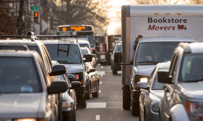 Cars sit in traffic along Florida Avenue in the Shaw neighborhood, in Washington, Wednesday, March 16, 2016. The Metro subway system that serves the nation's capital and its Virginia and Maryland suburbs shut down for a full-day for an emergency safety inspection of its third-rail power cables. Making for unusual commute, as the lack of service is forcing some people on the roads, while others are staying home or teleworking. (AP Photo/Andrew Harnik)
