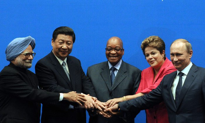 BRICS leaders (L-R) Indian Prime Minister Manmohan Singh, China's President Xi Jinping, South African President Jacob Zuma, Brazil's President Dilma Rousseff, and Russian President Vladimir Putin at summit in Durban on March 27, 2013. (Alexander Joe/AFP/Getty Images)