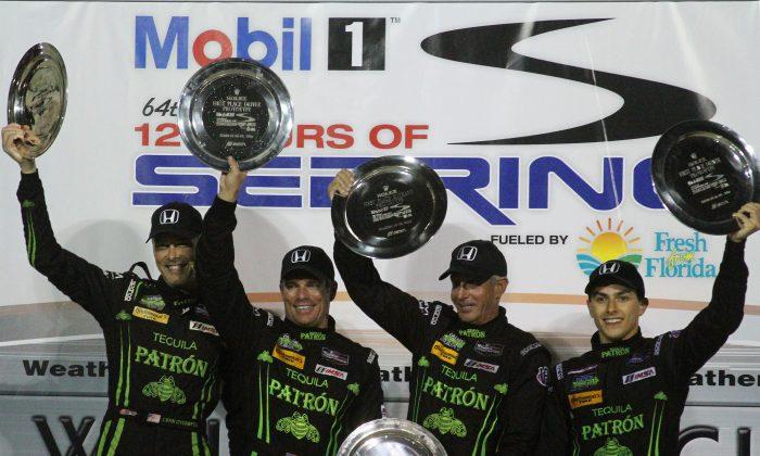 Extreme Speed Motorsports drivers Johannes van Overbeek, Scott Sharp, Ed Brown, and Luis Felipe Derani celebrate winning the Mobil 1 Twelve Hours of Sebring. (Chris Jasurek/Epoch Times)