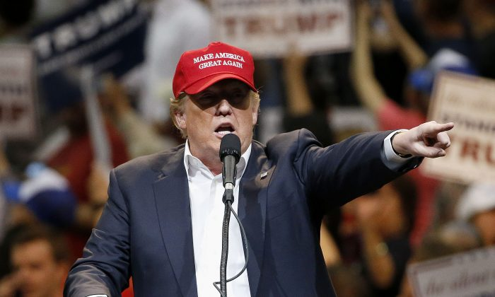 Republican presidential candidate Donald Trump speaks during a campaign rally, in Tucson, Ariz., on March 19, 2016. (AP Photo/Ross D. Franklin)