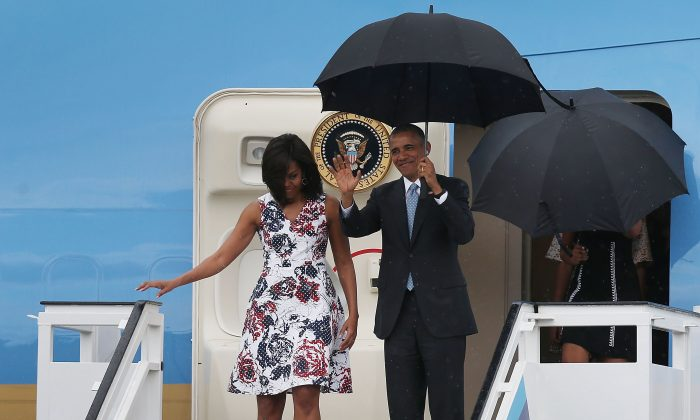 First lady Michelle Obama, President Barack Obama, Malia Obama and Sasha Obama arrive at Jose Marti International Airport for a 48-hour visit on Airforce One March 20, 2016 in Havana, Cuba. (Joe Raedle/Getty Images)