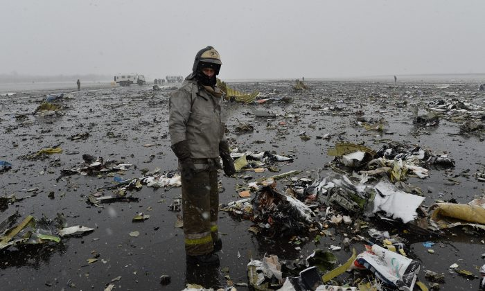 A Russian Emergency Ministry employee stands next the wreckage of a crashed plane at the Rostov-on-Don airport, about 600 miles south of Moscow, Russia, on March 19, 2016. (AP Photo)