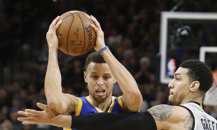 Stephen Curry of the Golden States Warriors scored just 14 points in a loss to the San Antonio Spurs. (Ronald Cortes/Getty Images)