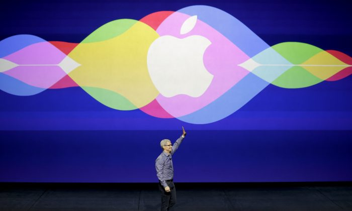 FILE - In this Wednesday, Sept. 9, 2015, file photo, Apple CEO Tim Cook waves during the Apple event at the Bill Graham Civic Auditorium in San Francisco. Apple is expected to unveil some new additions to its current family of iPhone and iPad devices at the company's product announcement on Monday, March 21, 2016. So far, however, there have been no hints of any dramatic announcements, such as 2015's highly anticipated Apple Watch debut, or major initiatives like the company's long-rumored but yet-to-materialize streaming TV service. (AP Photo/Eric Risberg, File)