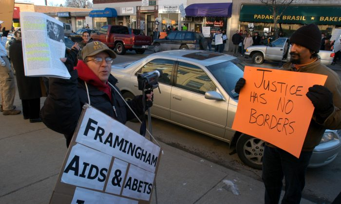 "An immigration protester, wishing to remain anonymous, left, and counter protester Suren Moodliar, right, demonstrate during a ""Stop the Invasion"" rally in Framingham, Mass., Saturday, Jan. 7, 2006.(AP Photo/William B. Plowman)"