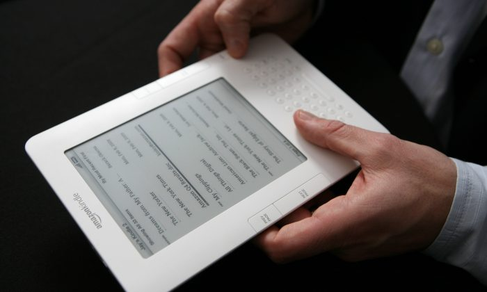 In this Feb. 9, 2009 file photo, the Kindle 2 electronic reader is shown at an Amazon.com news conference in New York.  (AP Photo/Mark Lennihan, file)