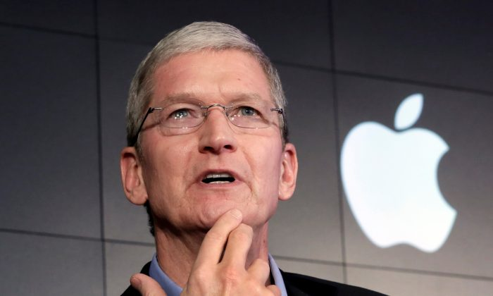 In this April 30, 2015 file photo, Apple CEO Tim Cook responds to a question during a news conference at IBM Watson headquarters, in New York. The dispute over whether Apple must help the FBI hack into a terror suspect's iPhone is about to play out in a Southern California courtroom. The hearing Tuesday, March 22, in U.S. District Court in Riverside is the first in the battle that has seen Cook and FBI Director James Comey spar over issues of privacy and national security. (AP Photo/Richard Drew, File)